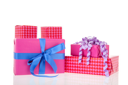 Pink gifts with checked wrapping paper and bow Stock Photo - 27144200
