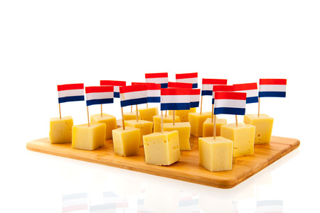 Dutch cheese cubes with flags isolated over white background photo