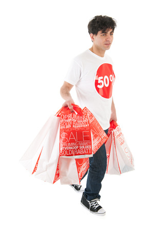 Young man is agitated by the sale with many bags