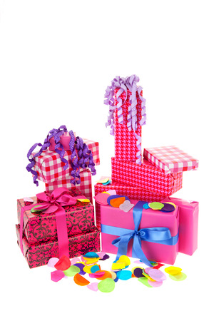 Pink gifts with checked wrapping paper and confetti photo