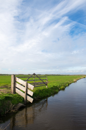 Landscape with fench and ditch in dutch polder Arkemheen photo
