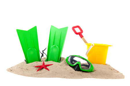 Beach with green diving equipment and yellow bucket photo