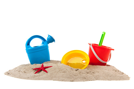 Plastic toys at the summer beach isolated over white background photo