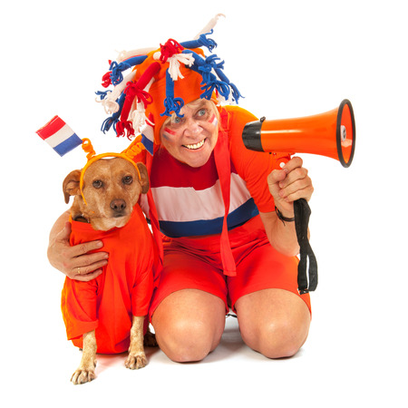 Dutch soccer supporter and her dog in orange with flags in orange photo