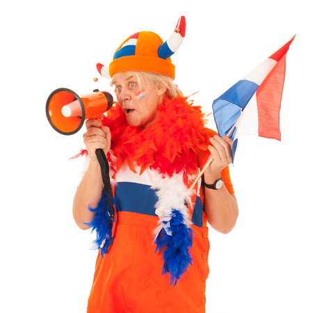 Funny senior woman as Dutch soccer supporter isolated over white background photo
