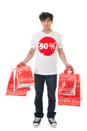 Young man is agitated by the sale with many bags photo