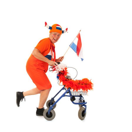 Funny senior woman as Dutch soccer supporter with walker photo