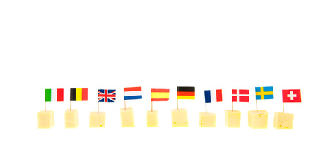 row cheese cubes with international flags isolated over white background photo
