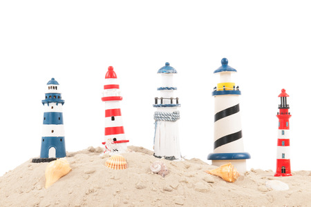 Many lighthouses at the beach isolated over white background photo