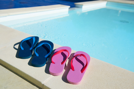 Flip flops for him and her at the swimming pool photo