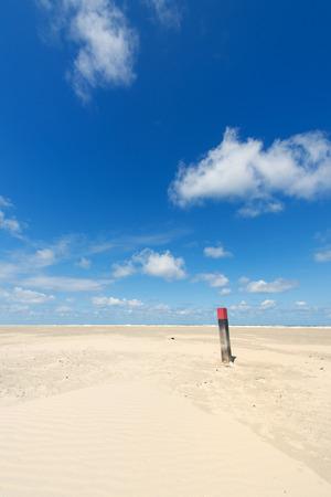 wadden: Wooden pole at the beach of Dutch wadden island Terschelling