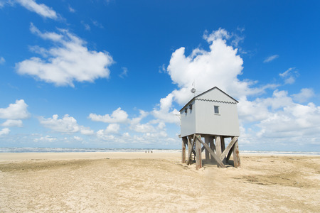 Drowning house at the beach from Dutch wadden island Terschelling photo