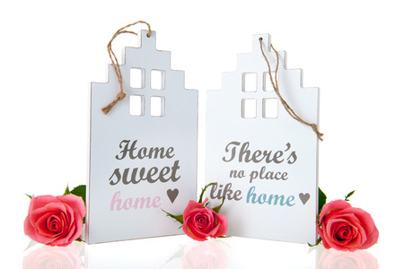 White miniature house with rose and home sweet home photo