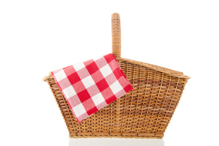 Picnic basket with red checked napkin isolated over white background