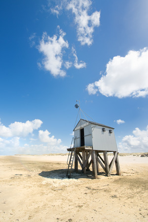 wadden: Drowning house at the beach from Dutch wadden island Terschelling