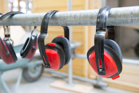 industrial noise: headphones for ear protection while loud noise Stock Photo
