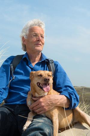 elderly man: Senior man with dog in nature