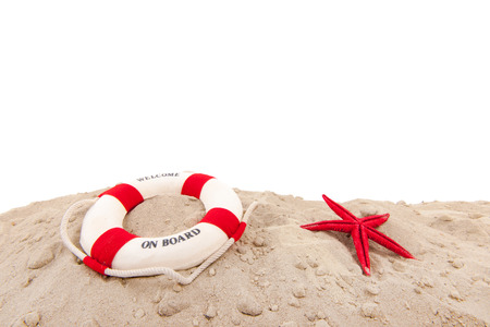 Life buoy wih welcome on board at the beach