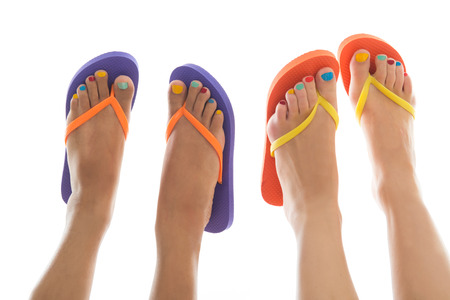 Black and white summer feet with colorful flip flops photo