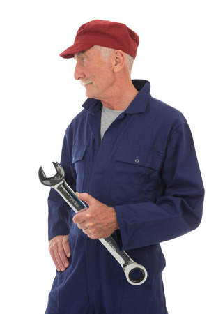 senior worker in blue overall with wrench isolated over white background photo