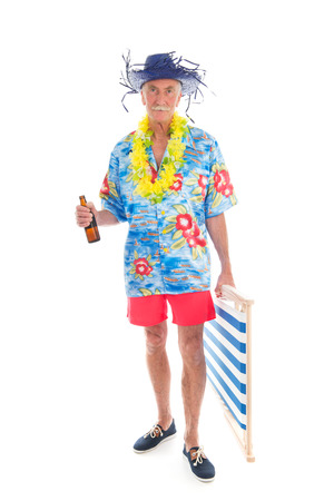 Senior man with beach chair and bottle beer isolated over white background photo