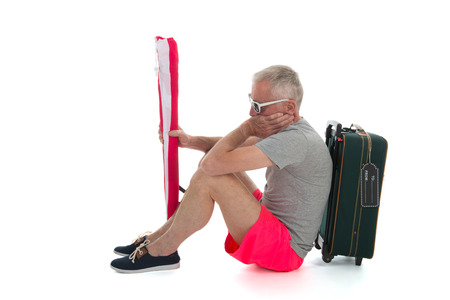 delay: Man as traveler with suitcase having delay