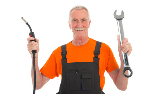 Senior laborer happy in orange and gray work wear with wrench isolated over white background photo