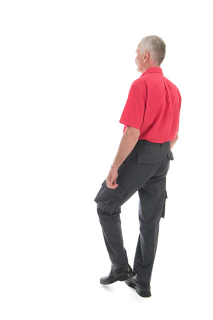 walk away: Retired man in red shirt walking away isolated over white background Stock Photo