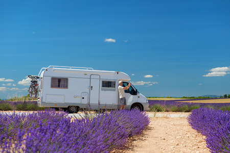 man with mobile home taking pictures at French lavender field in the south of France photo