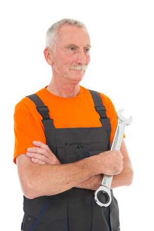 Senior laborer in orange and gray work wear with wrench isolated over white background photo