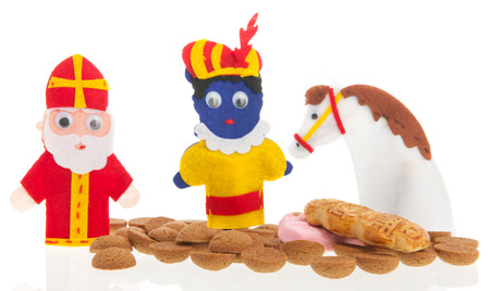 Handmade puppets and typical candy for Dutch Sinterklaas holidays photo