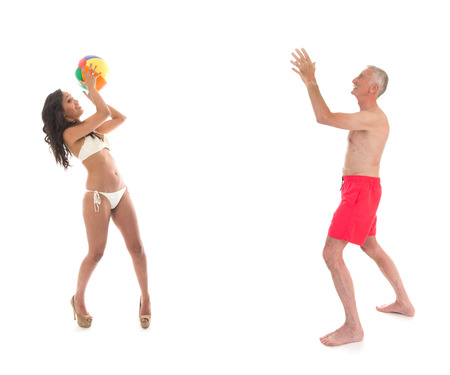 Man and woman playing a ball game at the beach photo