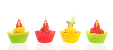 sinterklaas: Home made Sinterklaas cupcakes isolated over white background