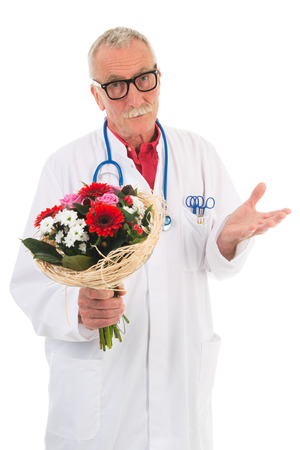 forgiving: doctor is giving flowers to say I am wrong isolated over white background