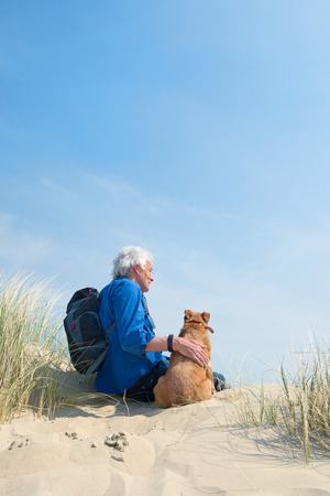 Senior man with dog in nature photo