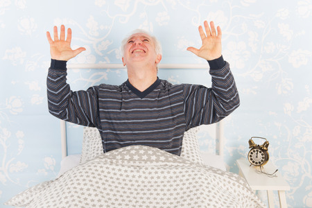 noise pollution: Man at night having problems with noise from the neighbours above Stock Photo