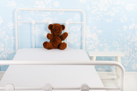 Bed with handmade bear for a child