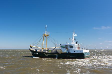 Fishing boat at the Dutch wadden sea photo