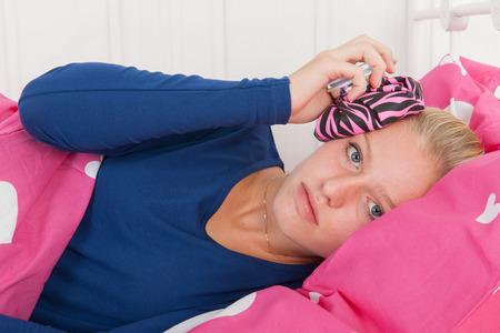 Fourteen year old girl is having a headache Stock Photo