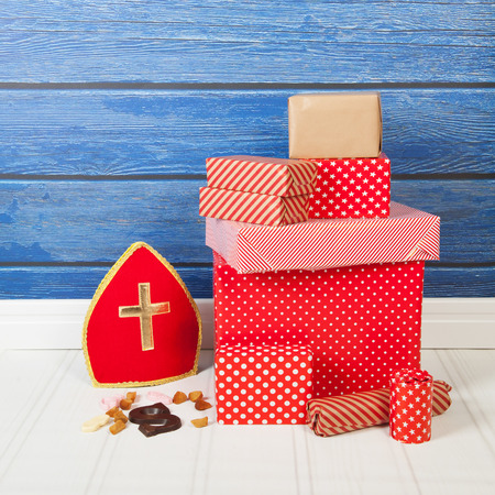 Typical Dutch Sinterklaas holidays with gifts, mitre and letter photo