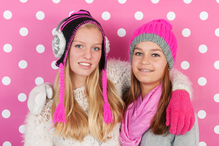 fourteen: Two fourteen years old teens as girlfriends in winter Stock Photo