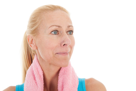 exercitation: Portrait mature woman in fitness clothing isolated over white background
