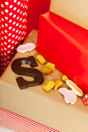 sinterklaas: Dutch Sinterklaas candy on red presents Stock Photo