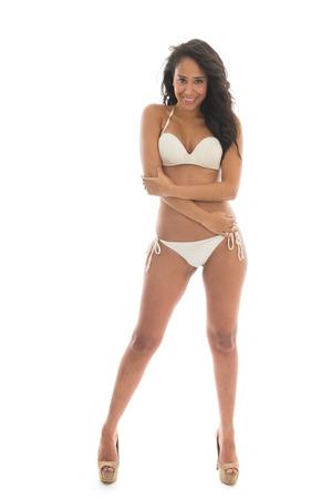 Black woman in bikini isolated over white background Stock Photo