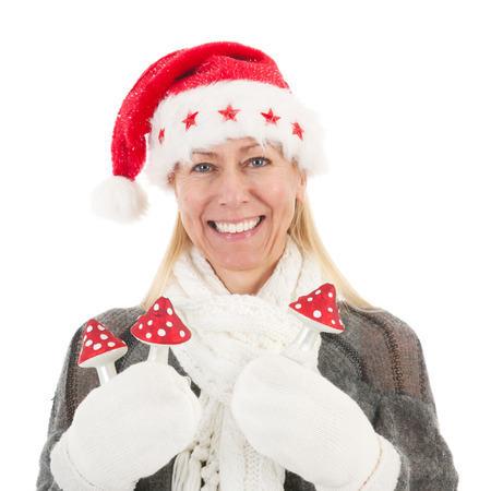 Middle aged woman portrait with hat of Christmas Santa Claus photo
