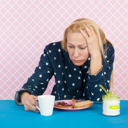 major depression: Depressive woman with breakfast in the morning Stock Photo