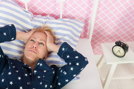 exhausting: Blond woman of mature age with insomnia