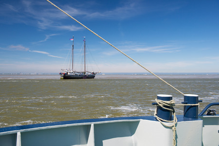 bollards: Bollards on ship with ropes at the sea