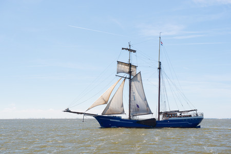 wadden sea: Clipper with sails on Dutch wadden sea