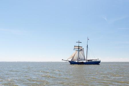 clipper: Clipper with sails on Dutch wadden sea